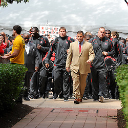 Sep 7, 2009; Piscataway, NJ, USA; Rutgers head coach Greg Schiano leads his team down the Scarlet Walk before Rutgers hosts Cincinnati in NCAA college football at Rutgers Stadium.