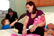 (from left) Rylan Stoltz, 17 months; Craig Stoltz, Ashley Martin and Kailynn Stoltz.  Kailynn is the first baby born at Miami Valley Hospital, and the area, at 1:33 a.m., photographed in their room at the MVH's Berry Building, Tuesday, January 1, 2013.