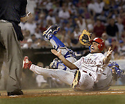 National Headliner 1st. Place Sports award.  Phillies third baseman Placido Polanco is put out at home plate by Dodgers catcher Paul Lo Duca and looks up to home plate ump Joe West about the call in the 5th inning.