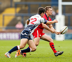 Bristol Scrum-Half Dwayne Peel (capt) offloads as Yorkshire Carnegie replacement Harry Leonard tackles - Photo mandatory by-line: Rogan Thomson/JMP - 07966 386802 - 14/09/2014 - SPORT - RUGBY UNION - Leeds, England - Headingley Carnegie Stadium - Yorkshire Carnegie v Bristol Rugby - Greene King IPA Championship.