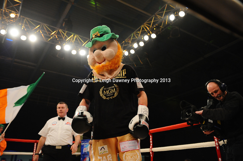 Peter McDonagh enters the ring with charactetuer head garnet before fighting for Vacant Irish Light Middleweight Title on 15th March 2014 at the Rivermead Leisure Centre, Reading, Berkshire. Promoted by Hennessy Sports. © Leigh Dawney Photography 2014.