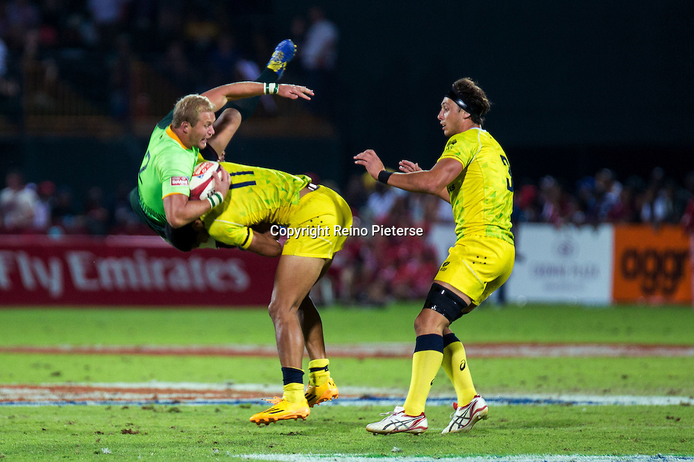 Dubai UAE, this spear tackle on Philip Snyman resulted in a yellow card for Australia during the IRB Rugby 7's. 6th December 2014. Photo by Reino Pieterse/SPORTDXB