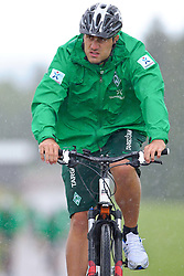 22.07.2011, Oeschberghof, Donaueschingen, Trainingslager 2011 GER, 1.FBL, Werder Bremen Trainingslager Donaueschingen 2011, im Bild Sokratis Papastathopoulos (Bremen #22) faehrt mit dem Rad zum ersten Training..// during the trainings session from GER, 1.FBL, Werder Bremen Trainingslager Donaueschingen 2011 on 2011/07/22,  Oeschberghof, Donaueschingen, Germany..EXPA Pictures © 2011, PhotoCredit: EXPA/ nph/  Kokenge       ****** out of GER / CRO  / BEL ******