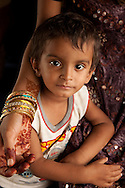 India - child with mother with henna tattoos