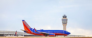 A Southwest Airlines jet about to depart from Atlanta's Hartsfield-Jackson International Airport.  Created by aviation photographer John Slemp of Aerographs Aviation Photography. Clients include Goodyear Aviation Tires, Phillips 66 Aviation Fuels, Smithsonian Air & Space magazine, and The Lindbergh Foundation.  Specialising in high end commercial aviation photography and the supply of aviation stock photography for commercial and marketing use.