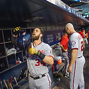 NEW YORK, NEW YORK - July 08: Bryce Harper #34 of the Washington Nationals in the dugout preparing to bat  during the Washington Nationals Vs New York Mets regular season MLB game at Citi Field on July 08, 2016 in New York City. (Photo by Tim Clayton/Corbis via Getty Images)