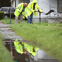 Tupelo Puplic Works employees Elmer Gilland and Johnny Miles continue cleaning storm drains Thursday in Mill Village as weeks of heavy rains have stopped many of the cities drains with leaves and other debris.