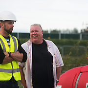 13 local activists locked themselves in specially made arm tubes to block the entrance to Quadrilla's drill site in New Preston Road, July 03 2017, Lancashire, United Kingdom. Pete Marquis chatting to the site manager at the Quadrilla drill site. Quadrilla's drill site after having cleared the wooden structures erected by activists outside Quadrilla's perimeter. The 13 activists included 3 councillors; Julie Brickles, Miranda Cox and Gina Dowding and Nick Danby, Martin Porter, Jeanette Porter,  Michelle Martin, Louise Robinson,<br />