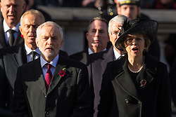 Labour Leader Jeremy Corbyn (left) and Prime Minister Theresa May sing the national anthem during the annual Remembrance Sunday Service at the Cenotaph memorial in Whitehall, central London, held in tribute for members of the armed forces who have died in major conflicts.