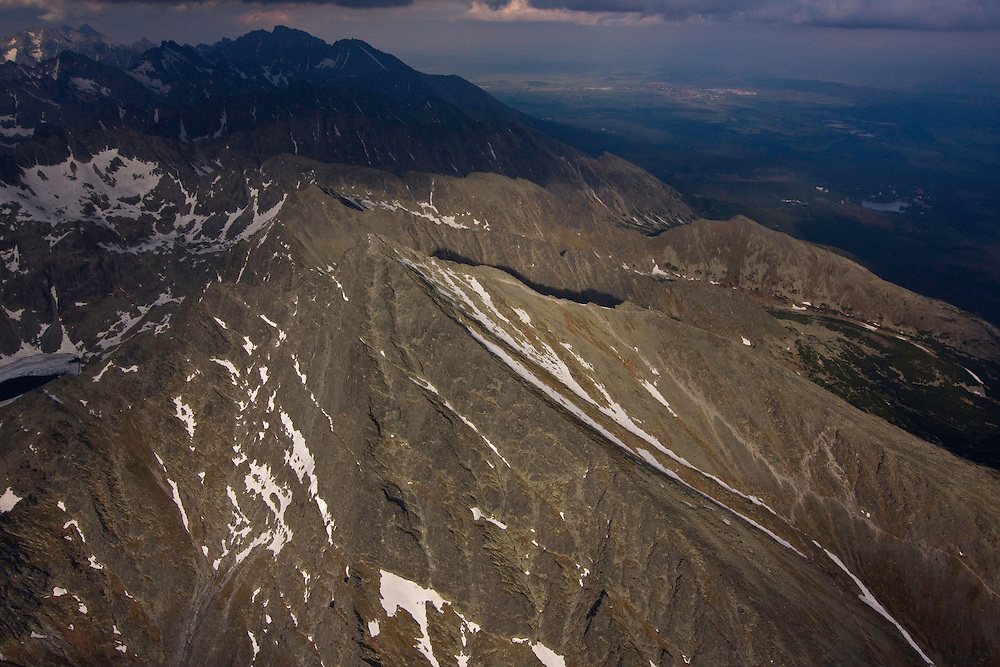 Aerial view of the western slope of Mount Krivàn (2495m als), national symbol of Slovakia, and Mount Gerlach (2655m als), highest peak in the Tatras, in the background. High Tatras, Slovakia. June 2009. Mission: Ticha