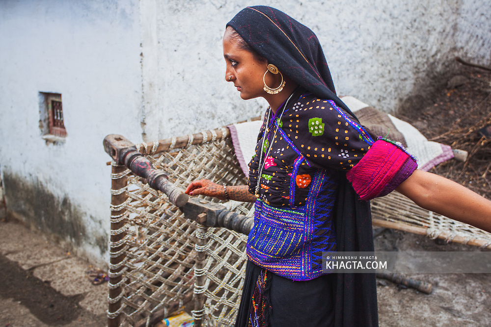 A girl from rural Gujarat staring at someone near his home in some village in Bhuj region.