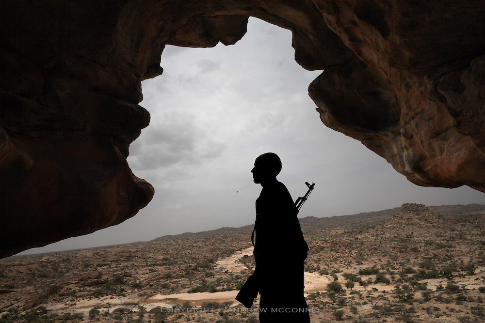 A soldier stands guard at the Lass Geel caves in Somaliland.