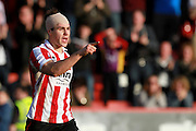 Dan Holman after scoring his second during the Vanarama National League match between Cheltenham Town and Boreham Wood at Whaddon Road, Cheltenham, England on 25 March 2016. Photo by Carl Hewlett.