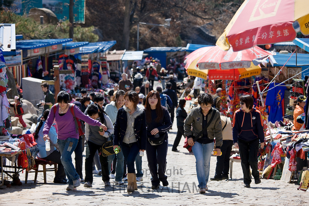 Tourists walk through souvenir stalls at The Great Wall of China, Mutianyu, north of Beijing