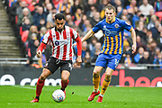Matt Green of Lincoln City (10) and Bryn Morris of Shrewsbury Town (16) in action during the EFL Trophy Final match between Lincoln City and Shrewsbury Town at Wembley Stadium, London, England on 8 April 2018. Picture by Stephen Wright.