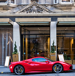 Ferrari parked outside Hilton Hotel Edinburgh in Old Town of Edinburgh, Scotland, United Kingdom