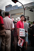 Tokyo - August 23th 2009 -  Jin Matsubara, local candidate of the Democratic Party of Japan (DPJ) in the 3rd district of Tokyo, salutes at Oimachi train station during the street speech of Yukio Hatoyama, president of DPJ and favorite for the seat of Prime Minister after the next general election