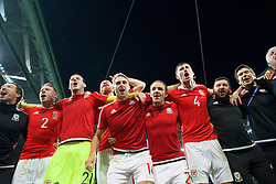 LILLE, FRANCE - Friday, July 1, 2016: Wales players celebrate in the team huddle following a 3-1 victory over Belgium and reaching the Semi-Final during the UEFA Euro 2016 Championship Quarter-Final match at the Stade Pierre Mauroy. Chris Gunter, goalkeeper Daniel Ward, James Collins, David Edwards, David Vaughan, Ben Davies, equipment manager David Griffiths, Doctor Rhodri Martin. (Pic by David Rawcliffe/Propaganda)