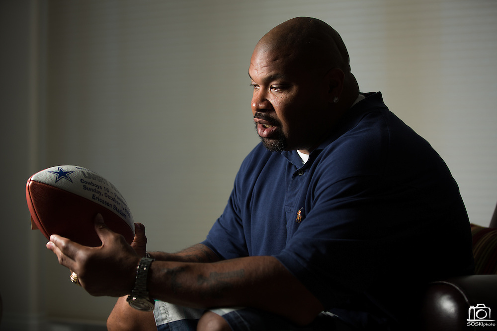 Former Dallas Cowboys guard Larry Allen, Jr. looks at his Offensive Game Ball from the Cowboys win over the Panthers, 16-13, in 2000, at his home in Danville, California, on June 27, 2013.  Allen will be inducted into the NFL Hall of Fame during the Enshrinement Ceremony at Fawcett Stadium in Canton, Ohio, on August 2, 2013. (Stan Olszewski for Fort Worth Star-Telegram)
