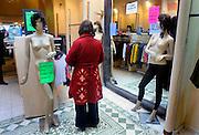 Nederland, Nijmegen, 7-2-2009Vrouw (van de fotograaf) past een jas in een winkel van dameskleding tijdens de uitverkoop.Foto: Flip Franssen/Hollandse Hoogte