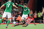 Brighton and Hove Albion midfielder Davy Propper (24) is tackled by Southampton midfielder Mario Lemina (18) during the Premier League match between Southampton and Brighton and Hove Albion at the St Mary's Stadium, Southampton, England on 17 September 2018.
