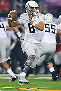 Marcus Mariota #8 of the Oregon Ducks drops back to pass against the Ohio State Buckeyes during the College Football Playoff National Championship Game at AT&T Stadium on January 12, 2015 in Arlington, Texas.  (Cooper Neill for The New York Times)