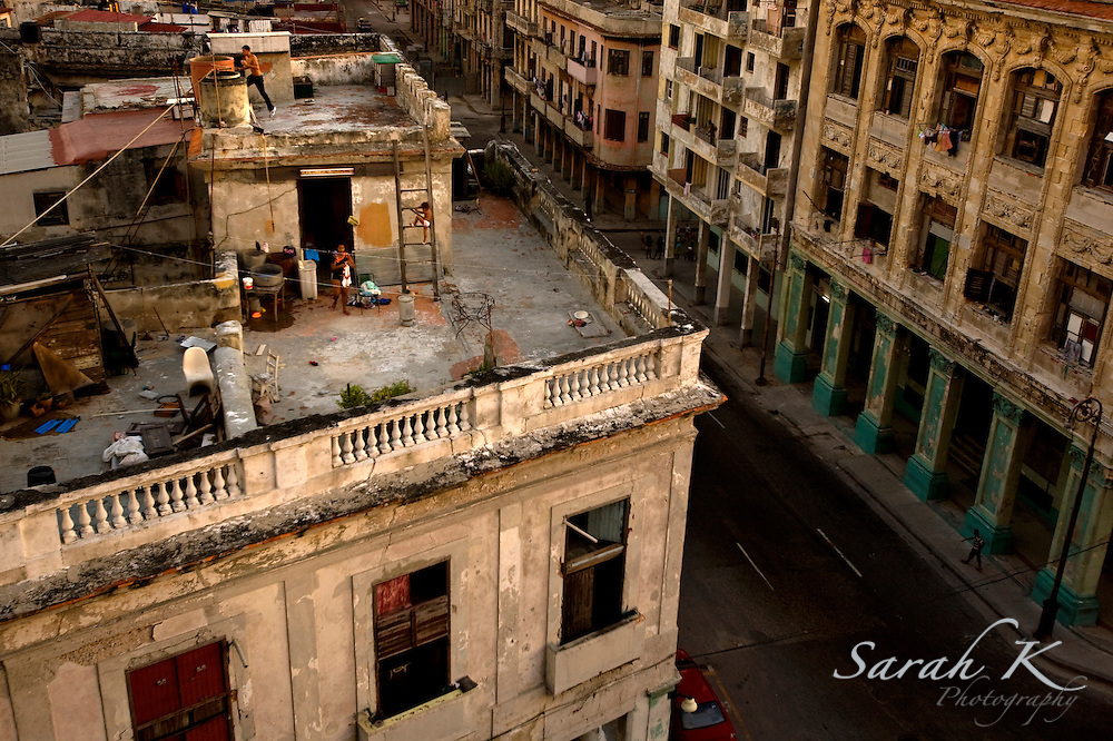 A family spends time together on a rooftop in Havana, Cuba.