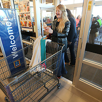 Caroline Floyd, of Blue Springs, was the first customer to walk in the new ALDI store during its grand opening on Wednesday morning. Floyd had been at the store at 10 PM the night before to claim her spot in line. The first 100 customers received a golden ticket, each containing ALDI gift cards of various amounts.