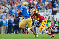 17 October 2012: Quarterback (17) Brett Hundley of the UCLA Bruins is sacked by (56) Anthony Sarao of the USC Trojans during the first half of UCLA's 38-28 victory over USC at the Rose Bowl in Pasadena, CA.