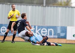 Falkirk's Will Vaulks holds Dundee's Steven Doris.<br /> half time : Falkirk 1 v 0 Dundee, 21/9/2013.<br /> &copy;Michael Schofield.