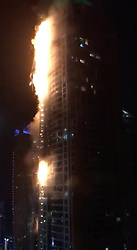&copy; Licensed to UK  News in Pictures. Friday 4th August 2017  GV Showing the Torch Engulfed in Flames The Torch Tower is the fifth tallest residential building in the world and stands at more than 330 metres (1,105 ft). <br /> It became the tallest residential building in the world in 2011 but lost the record the following year to the neighbouring Princess Tower. <br /> In February 2015 hundreds of residents were evacuated from the same building after it was engulfed in flames in the early hours of the morning.<br /> The blaze ripped through multiple floors of the new building, in the expat-heavy Marina district of the city.<br /> Flames shot out from two sides of the building and glass and metal rained down from the skyscraper.<br /> According to UAE civil defence teams, the fire spread uncontrollably partly due to flammable exterior cladding panels, similar to those used in Grenfell Tower. <br /> <br /> <br />  &copy;UKNIP