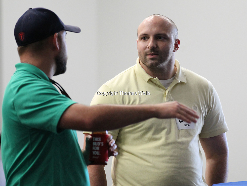 Aaron Carter, left, and Lee Cain chat about their jobs and the week during Thursday's Tupelo Young Professionals gathering at Mitchell Distributing in Shannon.