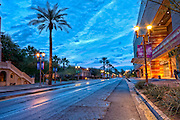 Looking down Monroe street at the sunrise in downtown Phoenix. Near the Phoenix Convention Center.