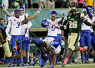 The Boise State sideline celebrates a diving catch for a first down by Boise State running back Jeremy McNichols against Colorado State at Hughes Stadium in Ft. Collins, Colo. on Saturday Oct. 10, 2015.