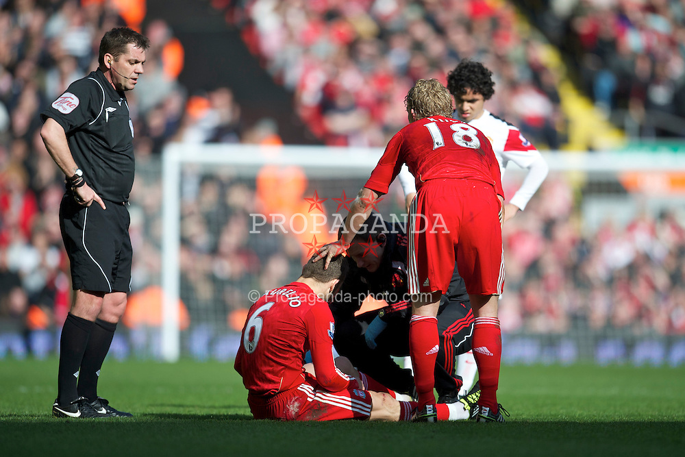 LIVERPOOL, ENGLAND - Sunday, March 6, 2011: Liverpool's Fabio Aurelio is treated for an injured as he is substituted during the Premiership match against Manchester United at Anfield. (Photo by David Rawcliffe/Propaganda)