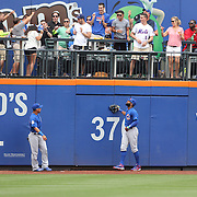 NEW YORK, NEW YORK - July 03: Jason Heyward #22 of the Chicago Cubs and Willson Contreras #40 of the Chicago Cubs watch as a home run from Rene Rivera #44 of the New York Mets clears the fence during the Chicago Cubs Vs New York Mets regular season MLB game at Citi Field on July 03, 2016 in New York City. (Photo by Tim Clayton/Corbis via Getty Images)