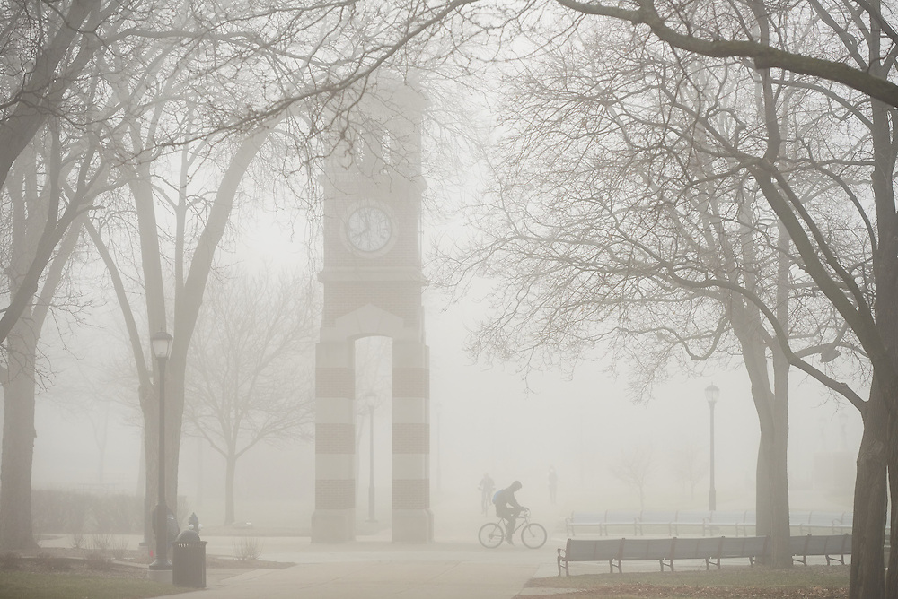 Buildings; Clock Hoeschler Tower; Location; Outside; People; Student Students; Spring; March; Time/Weather; foggy; Type of Photography; Candid; UWL UW-L UW-La Crosse University of Wisconsin-La Crosse