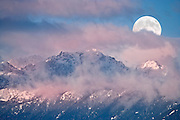 Moonset over Mt Constance in the Olympic Mountains from across the Hood Canal, Washington, USA