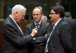 Luc Frieden, Luxembourg's finance minister,  center, speaks with Philippe Maystadt, president of the European Investment Bank, left, and Tonio Fenech, Malta's finance minister, right, during the emergency meeting of European Union finance ministers in Brussels, Belgium, on Sunday, May 9, 2010. (Photo © Jock Fistick)
