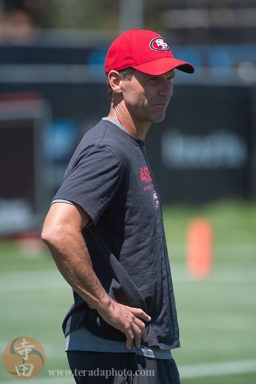 July 24, 2014; Santa Clara, CA, USA; San Francisco 49ers general manager Trent Baalke watches during training camp at the SAP Performance Facility.