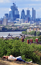 © Licensed to London News Pictures. 08/08/2018<br /> GREENWICH, UK.<br /> A bright sunny day across London and the South East with some patches of cloud.  Crowds of people flock to Greenwich Park to enjoy the fine weather.<br /> Photo credit: Grant Falvey/LNP