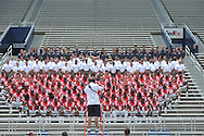 Ole Miss photographer Josh McCoy (foreground) takes the team photo during the team's media day, at Vaught-Hemingway Stadium in Oxford, Miss. on Friday, August 1, 2014. Mississippi begins practice Saturday morning and opens the season against Boise State in Atlanta on August 28, 2014.