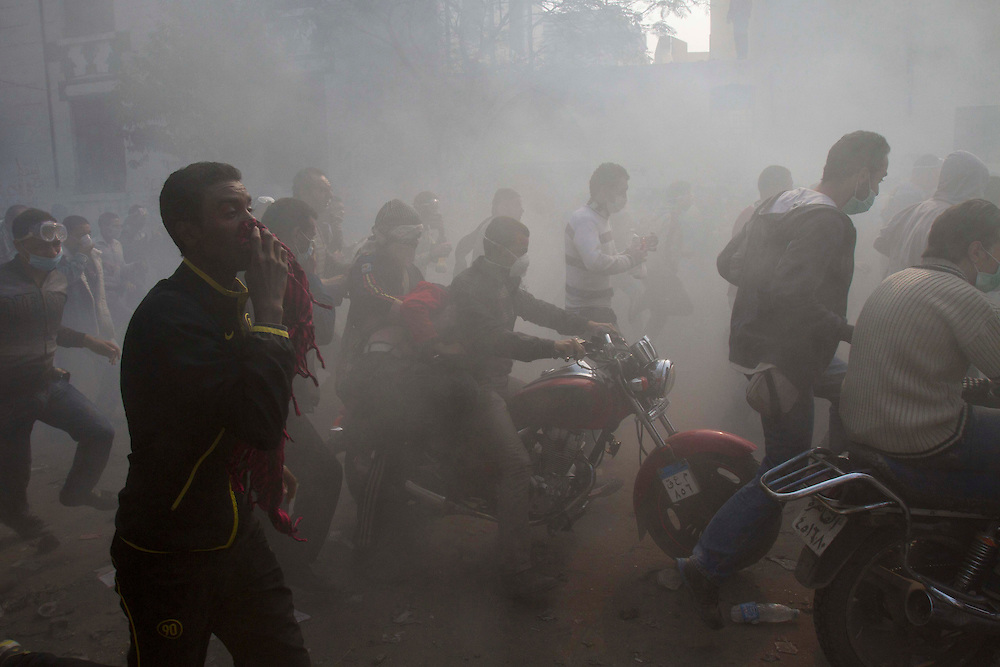 Egyptian demostrators run away from tear gas next to Tahrir Square on November 22, 2011 photo by: Maya Levin