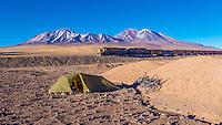 Train passing a tent, Atacama desert, north Chile