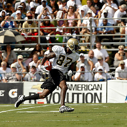 August 1, 2010; Metairie, LA, USA; New Orleans Saints wide receiver Adrian Arrington (87) runs after a catch during a training camp practice at the New Orleans Saints practice facility. Mandatory Credit: Derick E. Hingle