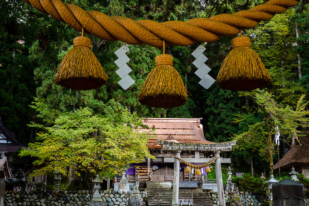 The entrance to places that are sacred in the japanese religion of Shinto, is often marked by straw ropes and strips of shide paper, as is the case of this small shrine in the village of Shirakawa-go