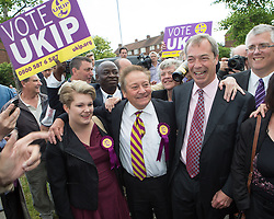 Nigel Farage visits Essex Today. The UKIP leader Nigel Farage gets surrounded by supporters in South Ockendon the day after the Council and European elections began showing strong success in  Essex for UKIP in Derwent Parade, South Ockendon, Essex, United Kingdom. Friday, 23rd May 2014. Picture by Daniel Leal-Olivas / i-Images