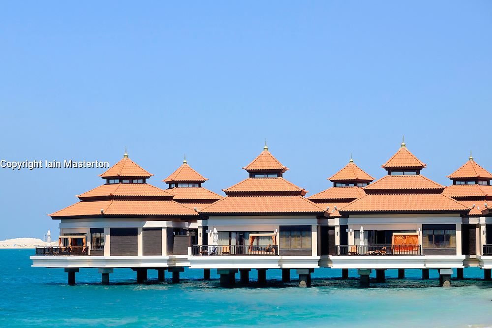 Thai style villas over water at  Anantara luxury resort and hotel on The  Palm Jumeira in Dubai United Arab Emirates