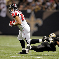 2009 November 02:  Atlanta Falcons tight end Tony Gonzalez (88) runs past a diving tackle attempt by New Orleans Saints linebacker Marvin Mitchell (50) in the first half during a 35-27 win by the Saints over the Falcons at the Louisiana Superdome in New Orleans, Louisiana.