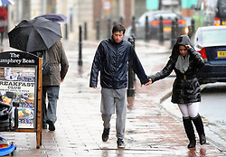 © Licensed to London News Pictures. 04/01/2016<br /> People attempt to shelter from heavy rain on Tonbridge High Street in Kent this afternoon. Photo credit: Grant Falvey/LNP
